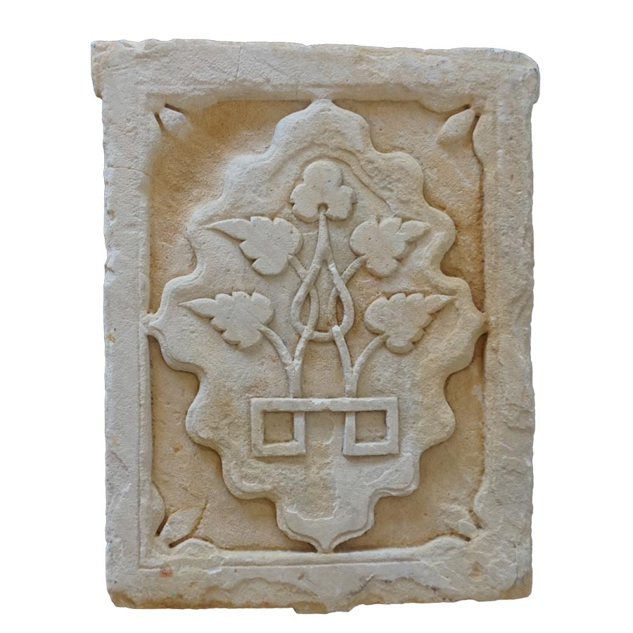 old carved sandstone flower panel