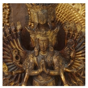 facial detail of vintage padmapani avalokiteshvara of copper and gold dust