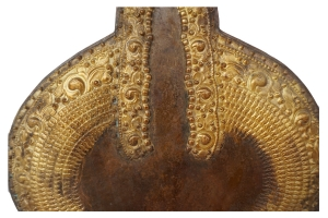 Detail of vintage padmapani avalokiteshvara, Tibetan deity made of copper with gold dust.