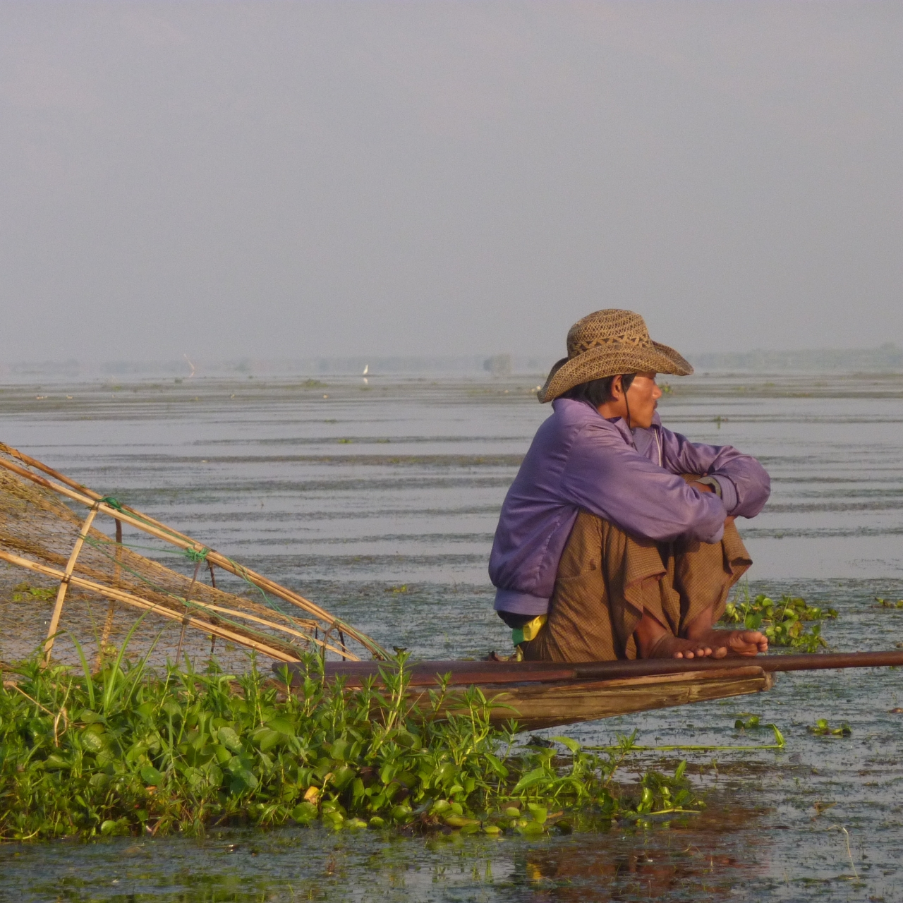 Early morning Inle Lake fisherman resting