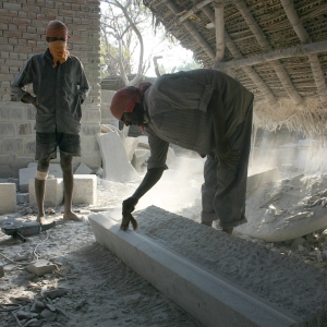 Carving the granite fireplace