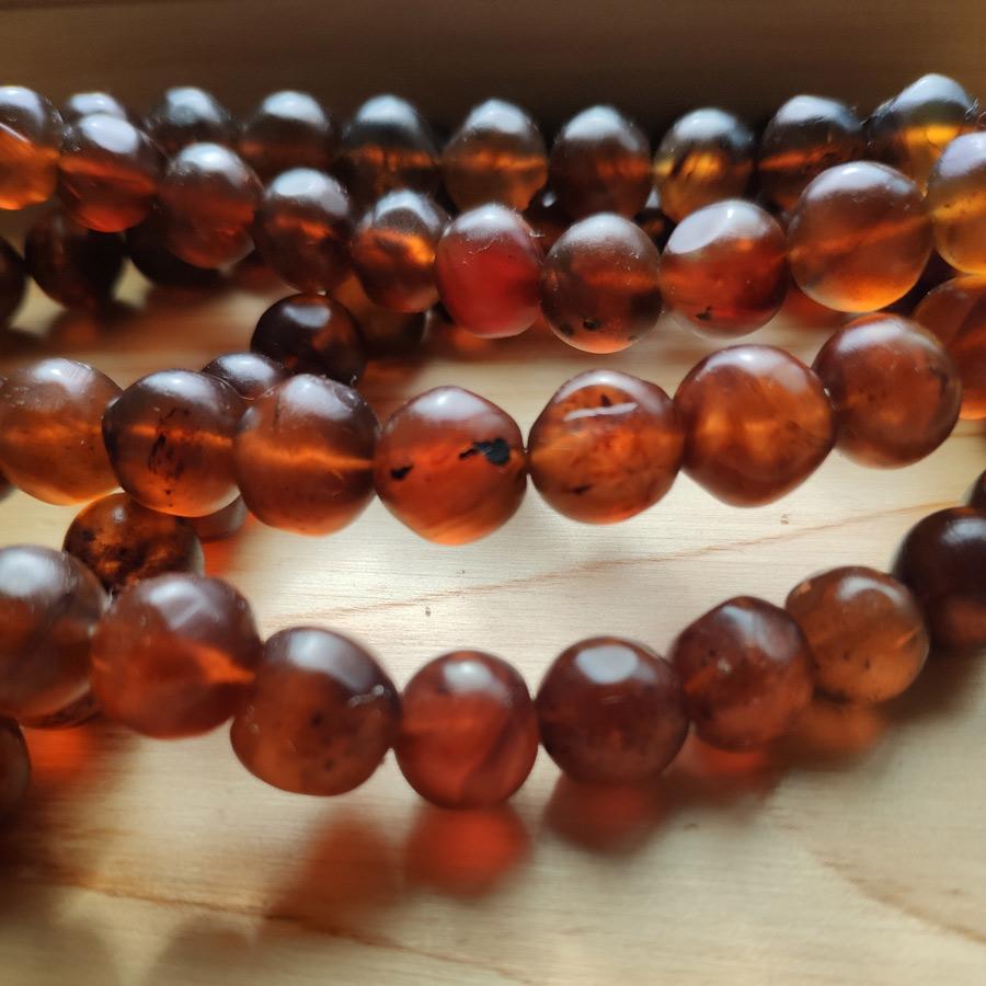 Detail close up of reddish-brown amber beads