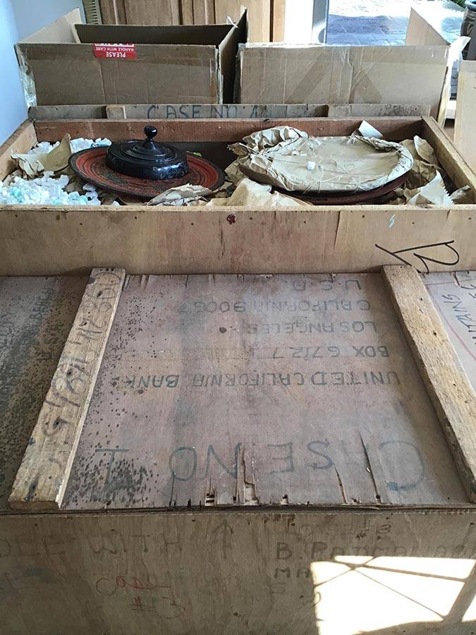 opening old crates of Burmese lacquerware from 1976
