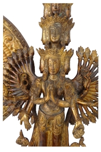 Facial detail of vintage padmapani avalokiteshvara, Tibetan deity made of copper with gold dust.