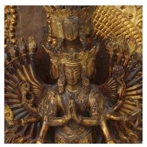facial detail of vintage padmapani avalokiteshvara of copper and gold dust